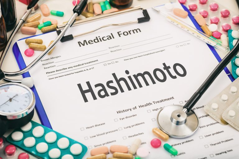 Medical form on a table diagnosis hashimoto thyroiditis