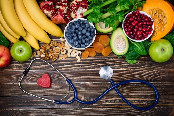 Background healthy food for heart. Healthy food, diet and life. Fresh fruits and vegetables, berries and nuts. Healthy heart concept