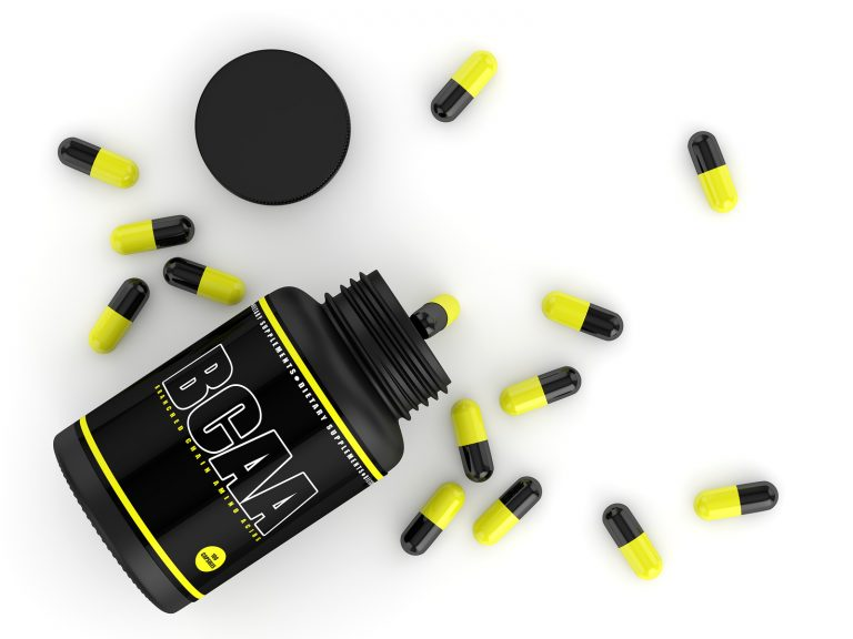 3d render of BCAA bottle with pills isolated over white background