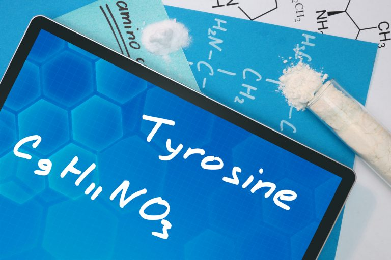 Tablet with the chemical formula of   Tyrosine . Amino acids.