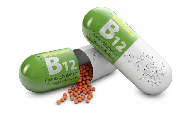 3d rendering vitamin B12 pills over white background. Concept of dietary supplements