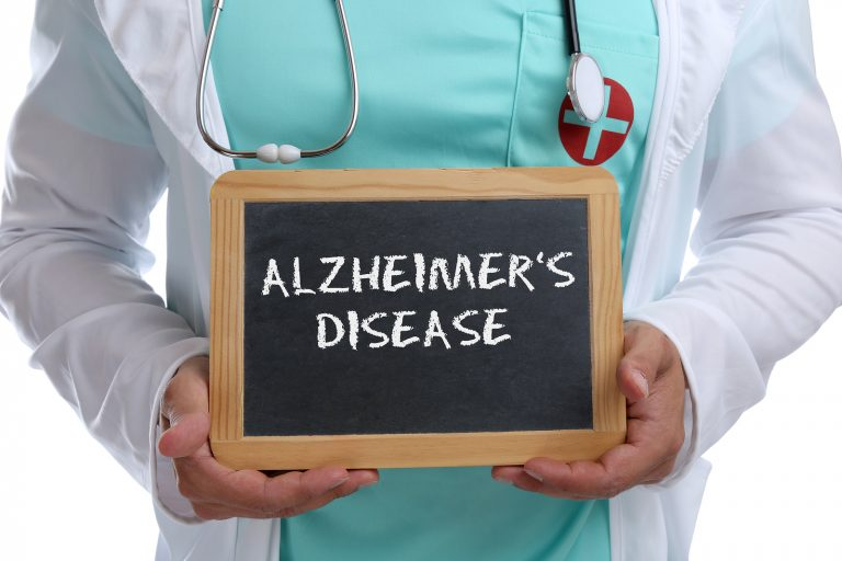 Alzheimers disease Alzheimer Alzheimer's ill illness healthy health young doctor with sign