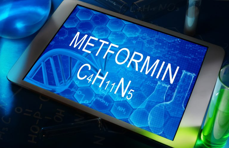 the chemical formula of Metformin on a tablet with test tubes