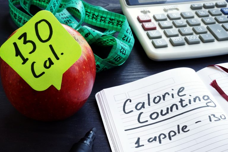 Calorie count concept. Apple and among calories.