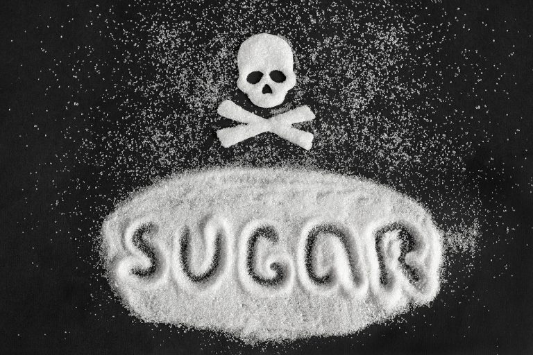 Text Sugar and skull shape from sugar on black background, Concept Sugar and sweet leads to diabetes. Diabetes Mellitus Killer Copy space World Diabetes Day 14 November